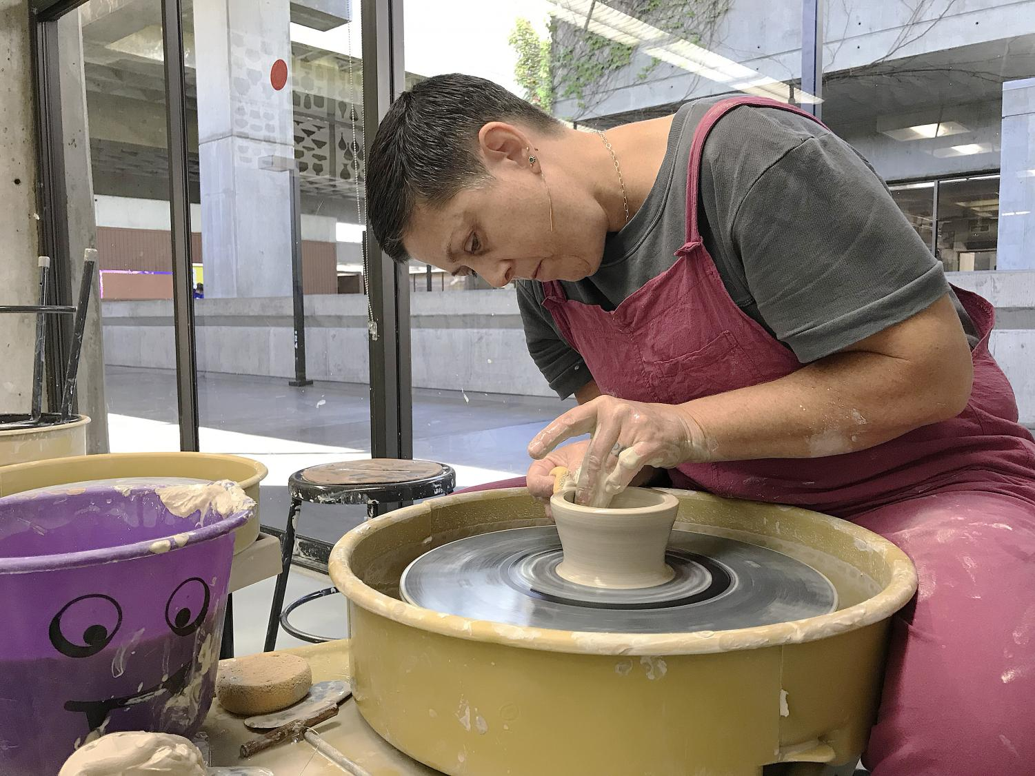 Ceramics student Tammie Lurley, who is donating bowls to the Empty Bowls event, crafts a ceramic bowl in the Art Department Oct. 3.