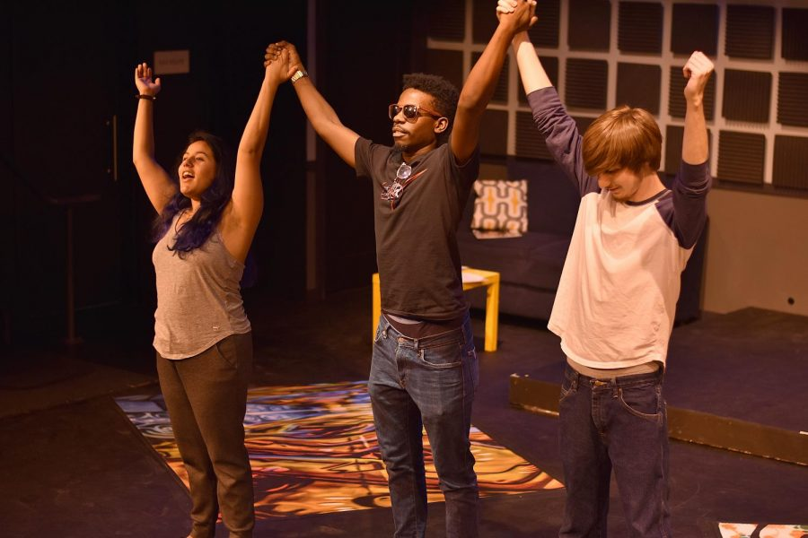 Kayla Martinez (left), William Thompson (center) and Jason Wolcott (right) strike a pose during a rehearsal of 'Hype Man.'