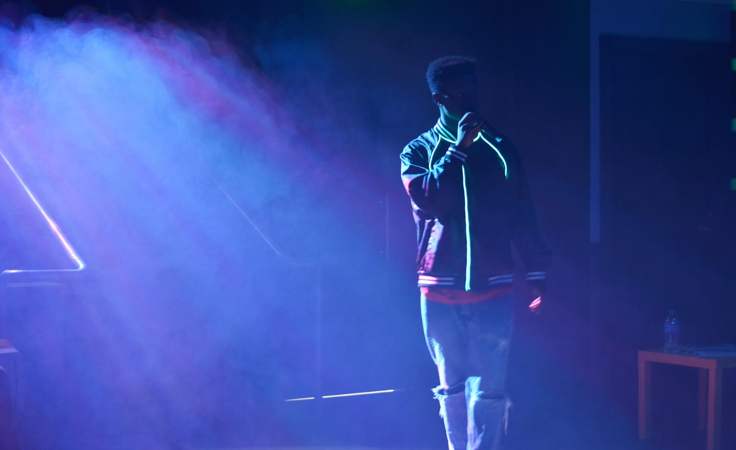 """Student actor William Thompson """"hypes the crowd"""" as he performs a rap song as character Verb during a dress rehearsal of 'Hype Man' Oct. 8 in the Little Theatre."""