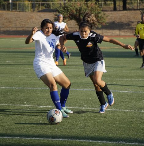 Mariah Minhares, No. 7, battles for the ball against a Merritt College player.