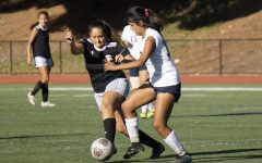 Jazmin Alaniz, No. 2, battles a Yuba College player for the ball during the second half of the game.
