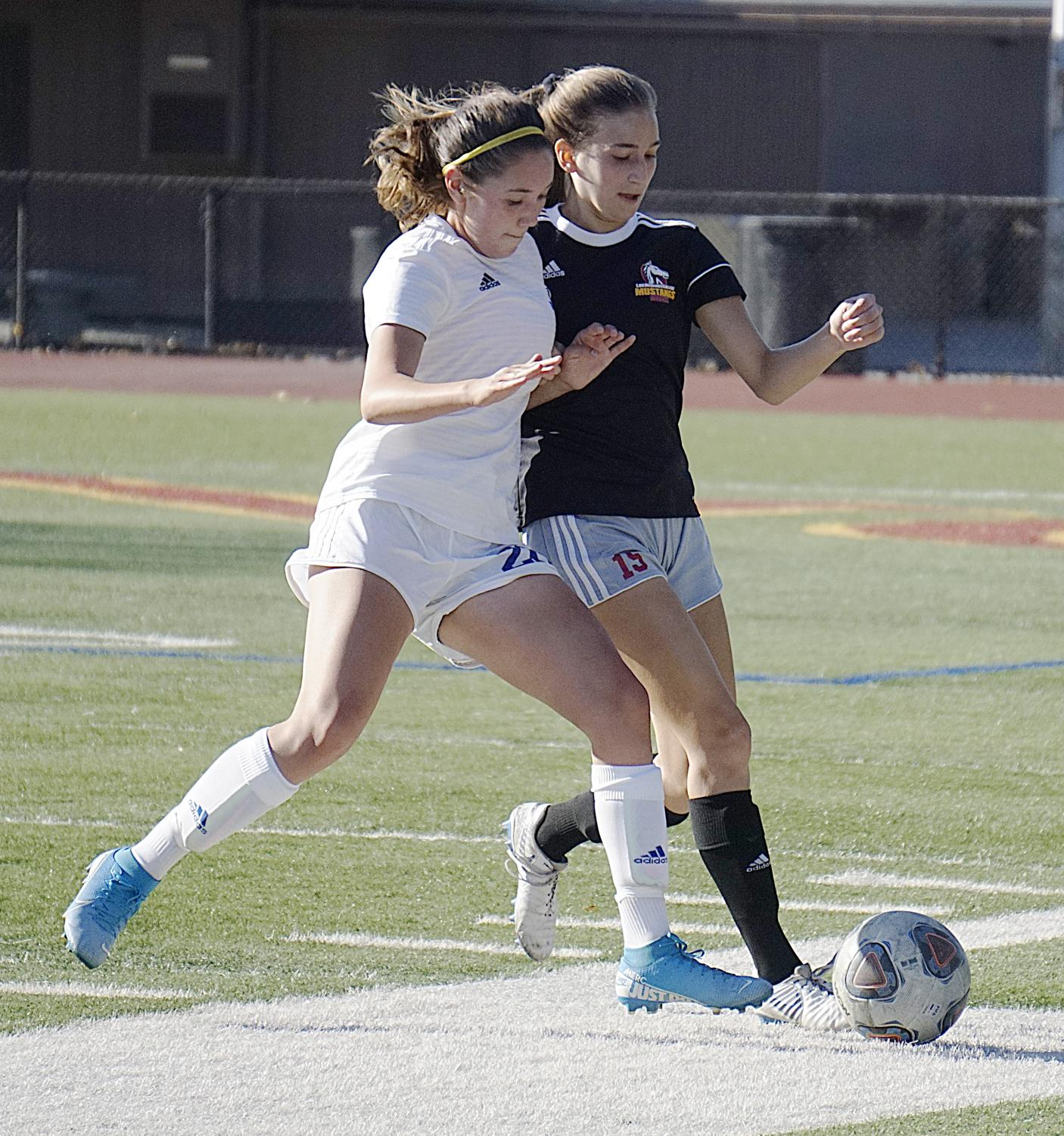 Eryn Wheatley, No. 15, battles for the ball during a defensive play in a soccer game against Solano College.