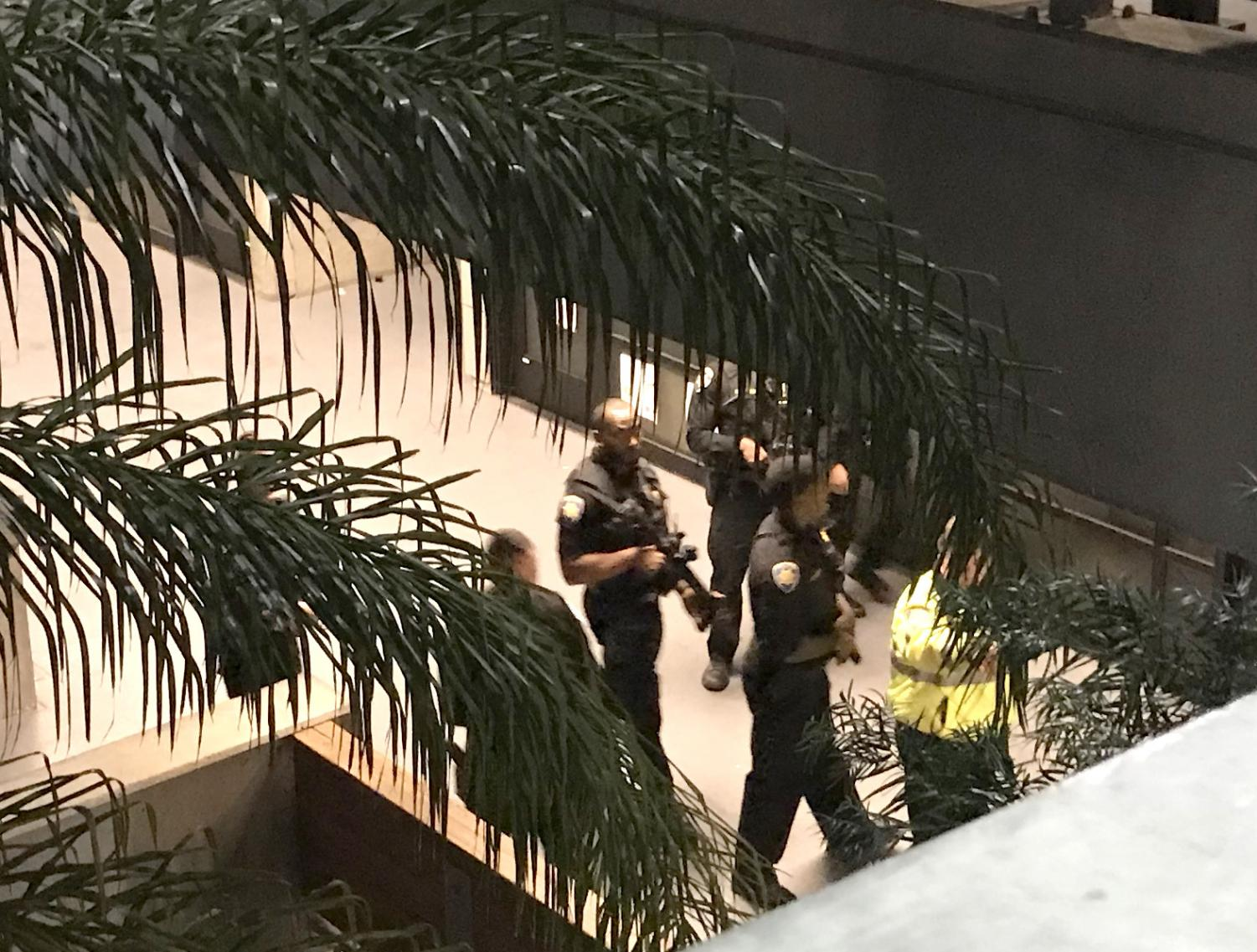 Pittsburg police surveying each floor of the College Complex at LMC.