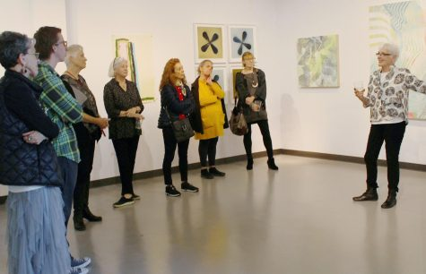 Gallery curator Carol Ladewig speaks to artists in conversation.