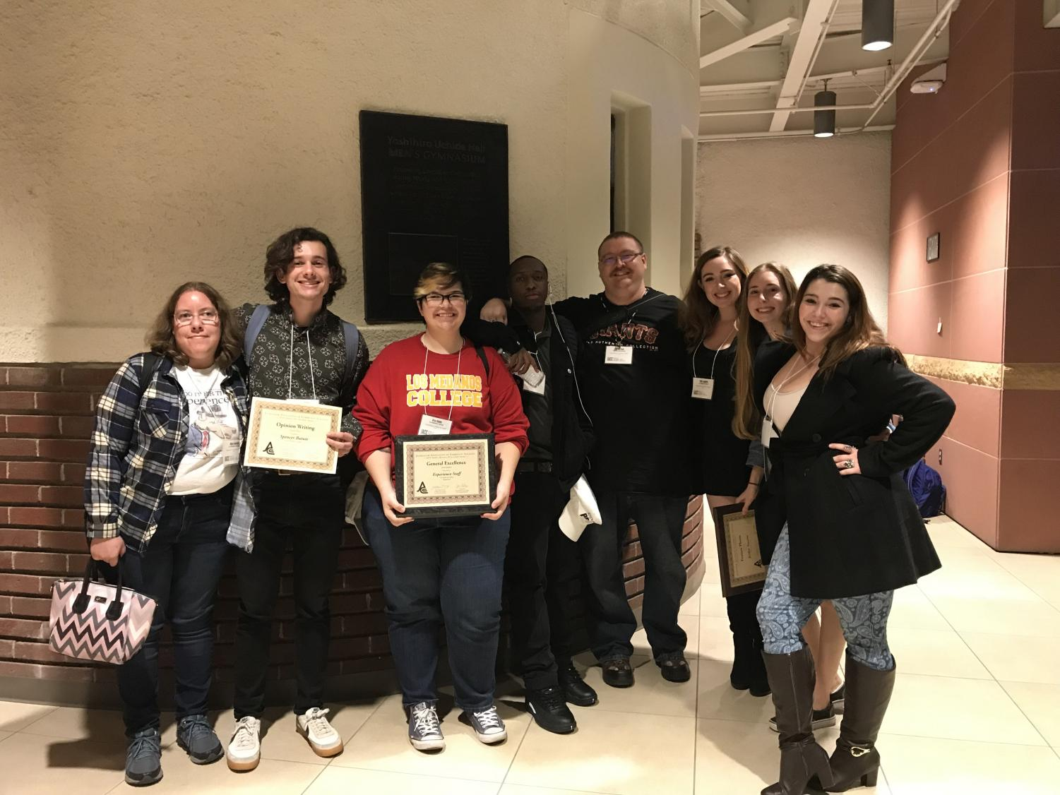 The Experience staff members showing off some of their 19 awards won at JACC.