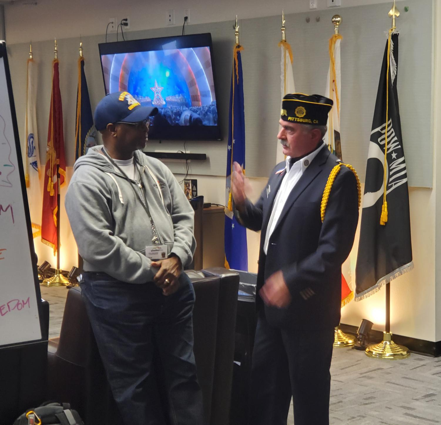 Ty Robinson and Alex Alexander talking at Veterans Center open house.