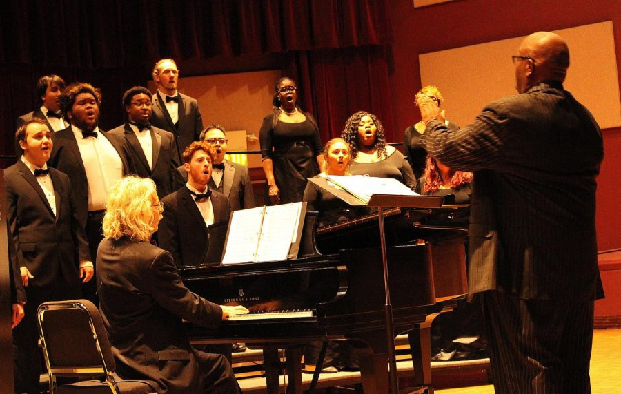 Silvester Henderson (right) conducts the chamber chorale/chorus at the Masterclass Recital.