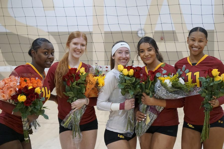 From eft to right, Jazlyn Avelino, Emily Sobolik, Joslin Sadler. Kristina Salazar, and Amaya Mixon pose for a photo during a pre-match ceremony during their final home game as Mustang volleyball players.