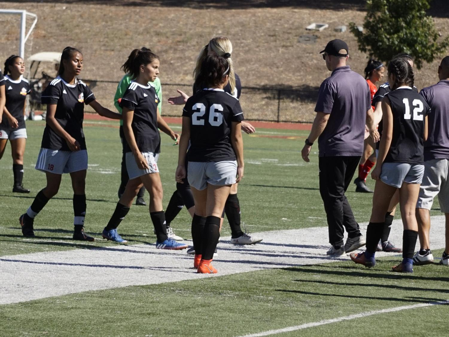 The LMC Women's Soccer team gathers to discuss their performance of the soccer game.
