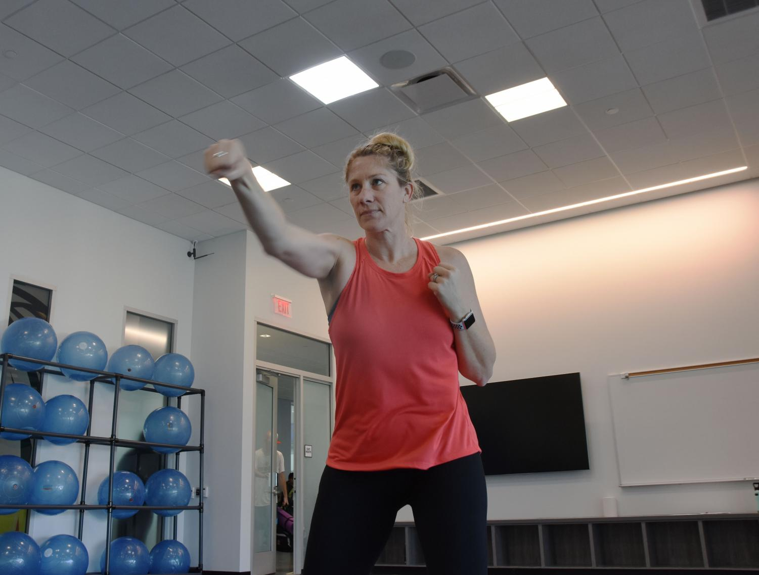 Sarah Stretch, the Kickboxing instructor at Los Medanos College, teaches and leads students in some kick boxing activities, Feburary 6, 2020 at Los Medanos College in Pittsburg Calif.