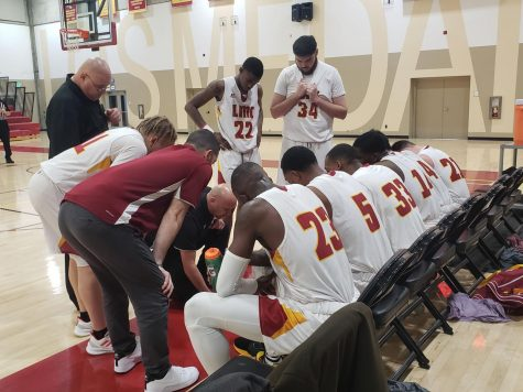 Head Coach Derek Domenichelli creates a play during a timeout during a basketball game against Solano College at Los Medanos College in Pittsburg, Calif on Friday, Jan. 31, 2020.