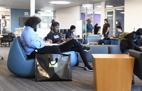 Students have a study session in the new Student Union building on the second floor.