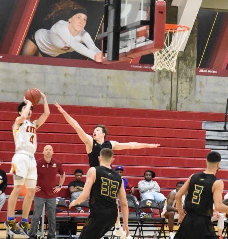 Zack Martinez, No. 4, shoots the ball in an attempt to score for during a basketball game against Napa Valley College.