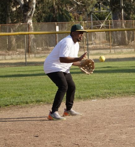 Clinton Calvin makes a catch during a staff softball game on Oct. 11, 2019.
