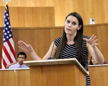 LMC speech professor Marie Arcidiacono speaks at the lectern during a debate in the Pittsburg City Hall Oct 30, 2015.