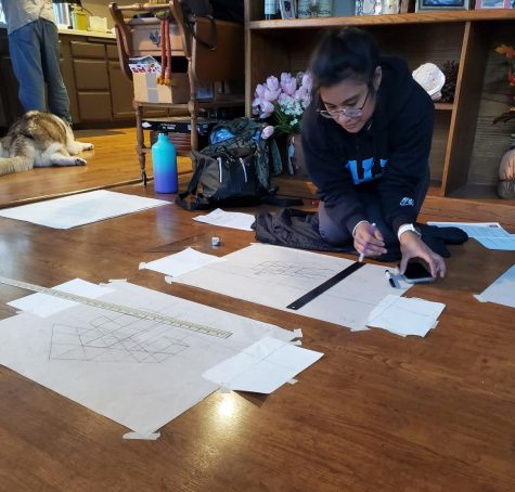 Kayla Quares works on a project for Ken Alexander's design drawing class. Photo taken March 18.