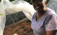Sandra Brooks shows off the coffee beans she grew on her farm in Costa Rica.