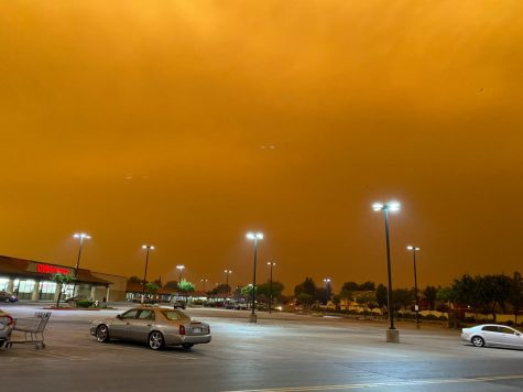 Orange sky consumes the sky at 9:00am in a parking lot off Atlantic Ave in Pittsburg.
