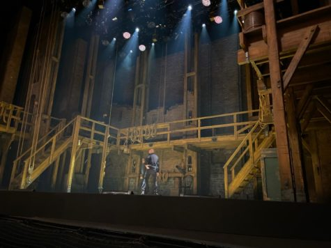 Stage hands check the set for the SF production of Hamilton during intermission on Aug. 25.