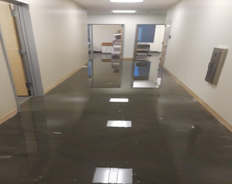 Water from the flood fills the administrative wing hallway within the new LMC Brentwood Campus.